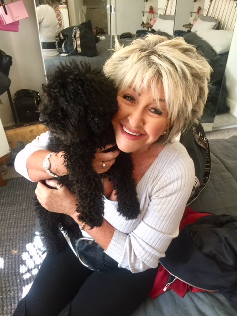 Maggie Oliver with a dog